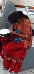 Young woman wearing the skirt and typical hand-embroidered blouse of her region.
