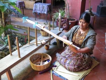 Weaver at her back-strap loom.