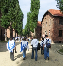 Visiting Israeli youth at Auschwitz draped in the flag of their country.